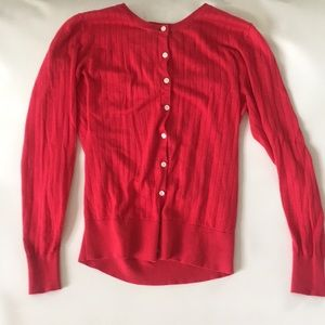 Red button up sweater